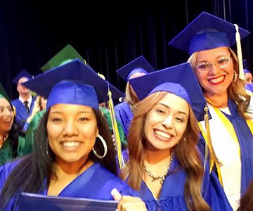 Three graduates at SJVC Bakersfield campus graduation ceremony