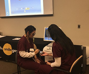 temecula-dental-assisting-students-training-on-cad-cam-machine
